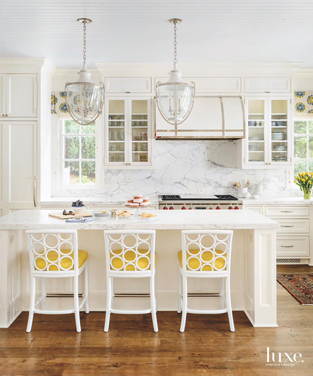 traditional white marble kitchen yellow accents