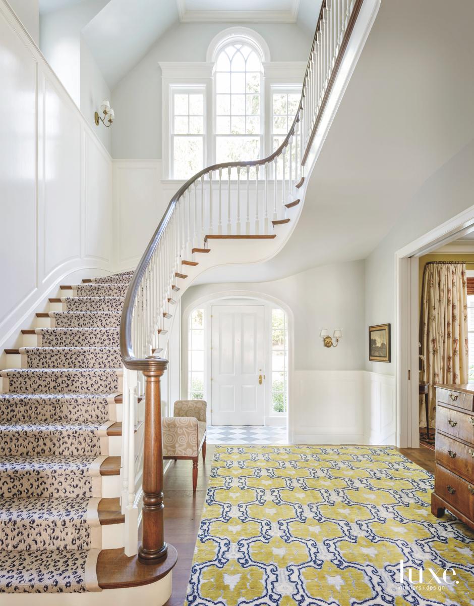 traditional white foyer cheetah stairs