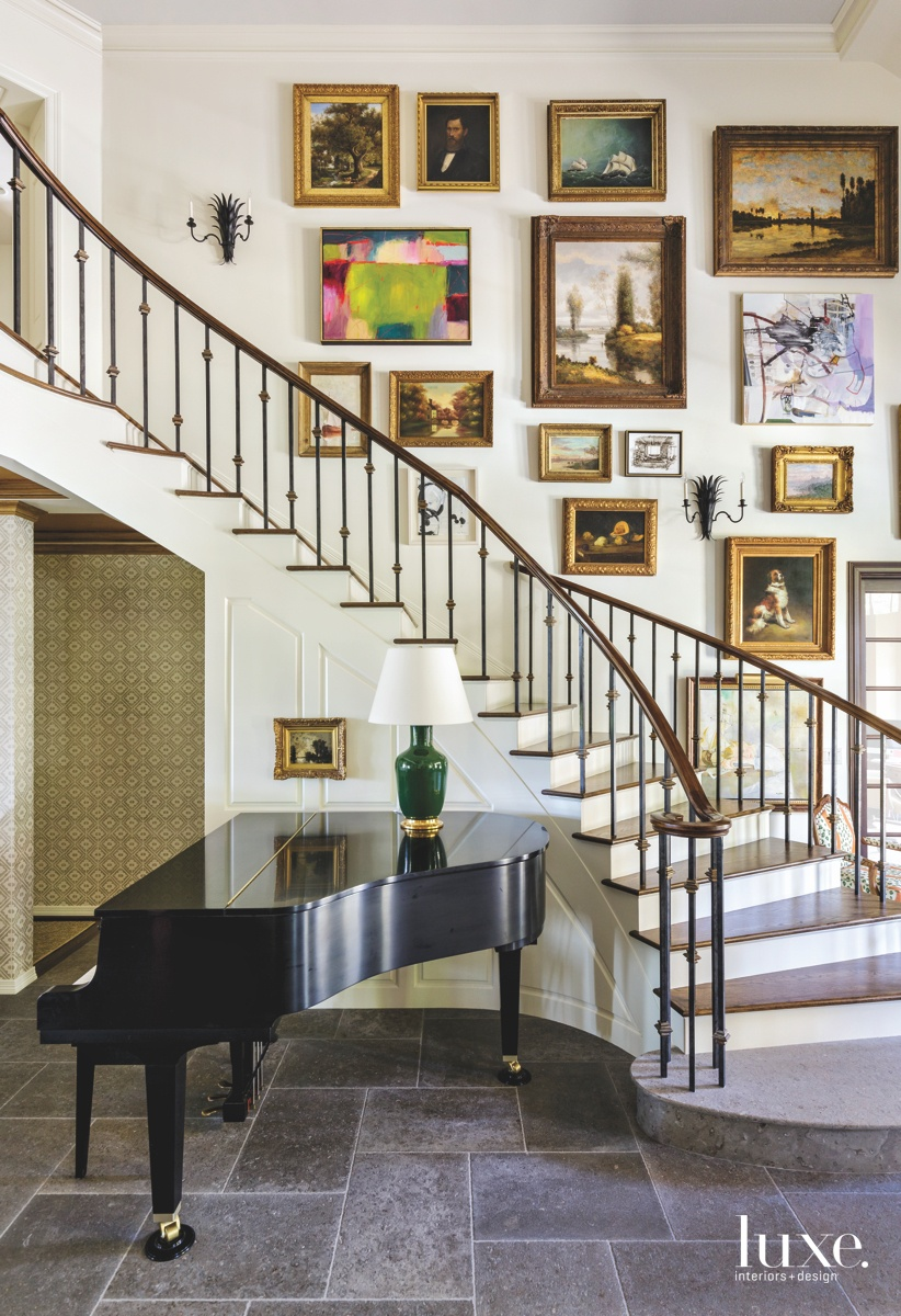traditional foyer entry staircase portraits...