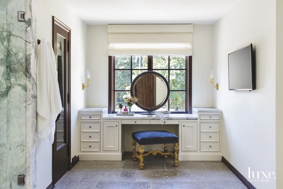 traditional master bathroom round mirror...