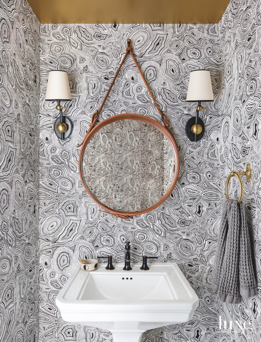 modern powder room leather-framed mirror...