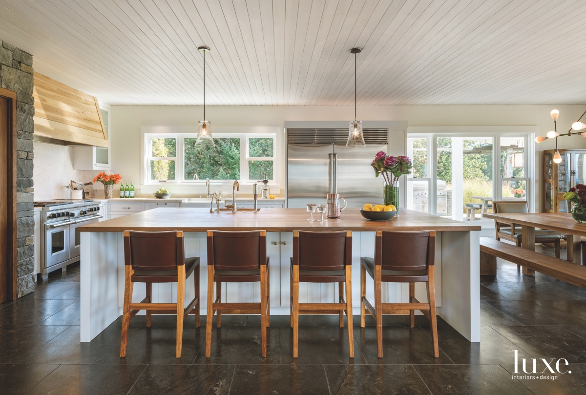 farmhouse kitchen brown barstools island...