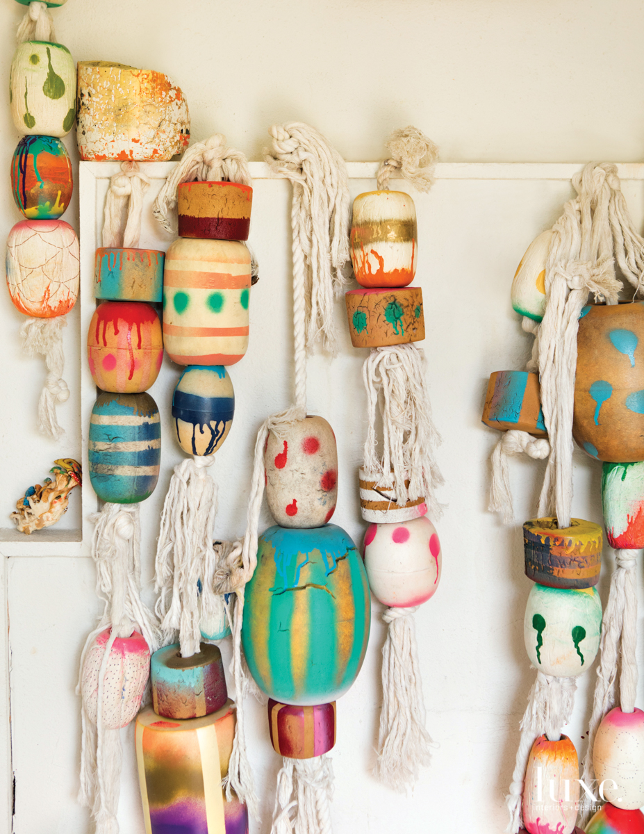 In Tran's studio are a collection of fishing floats, which she found, painted and then strung together.