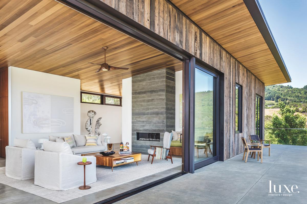 contemporary neutral living room glass...