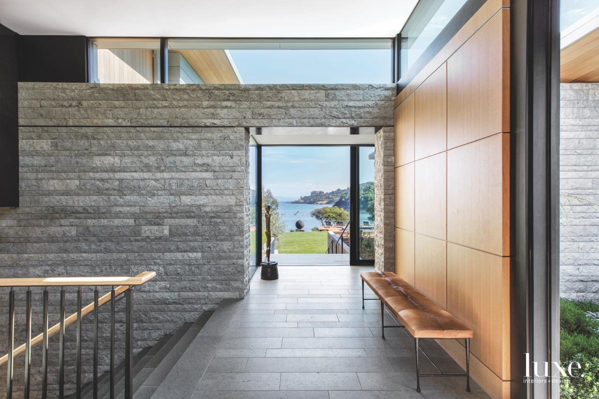 modern gray foyer stairs glass...