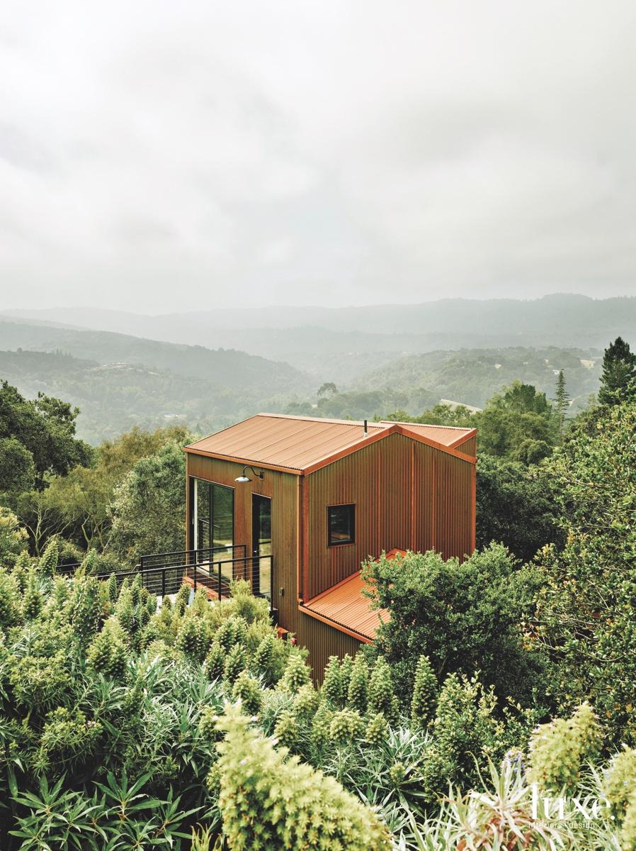 midcentury modern exterior brown guest...
