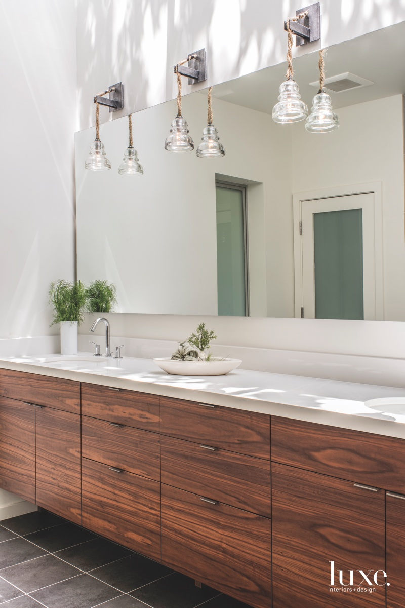 eclectic bathroom walnut cabinetry stone...