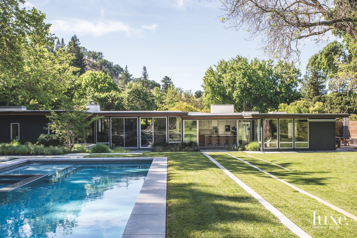 eclectic backyard pool landscape