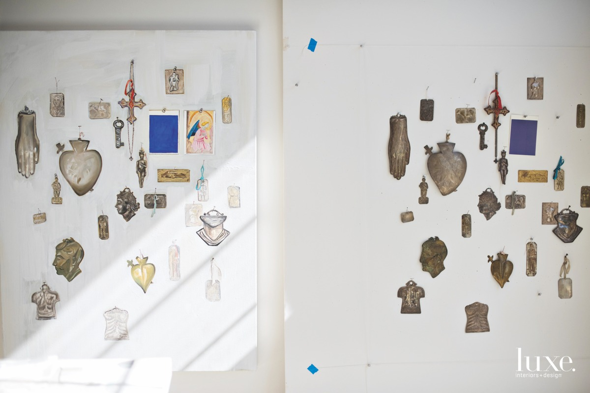 A work in progress shows a collection of milagros.