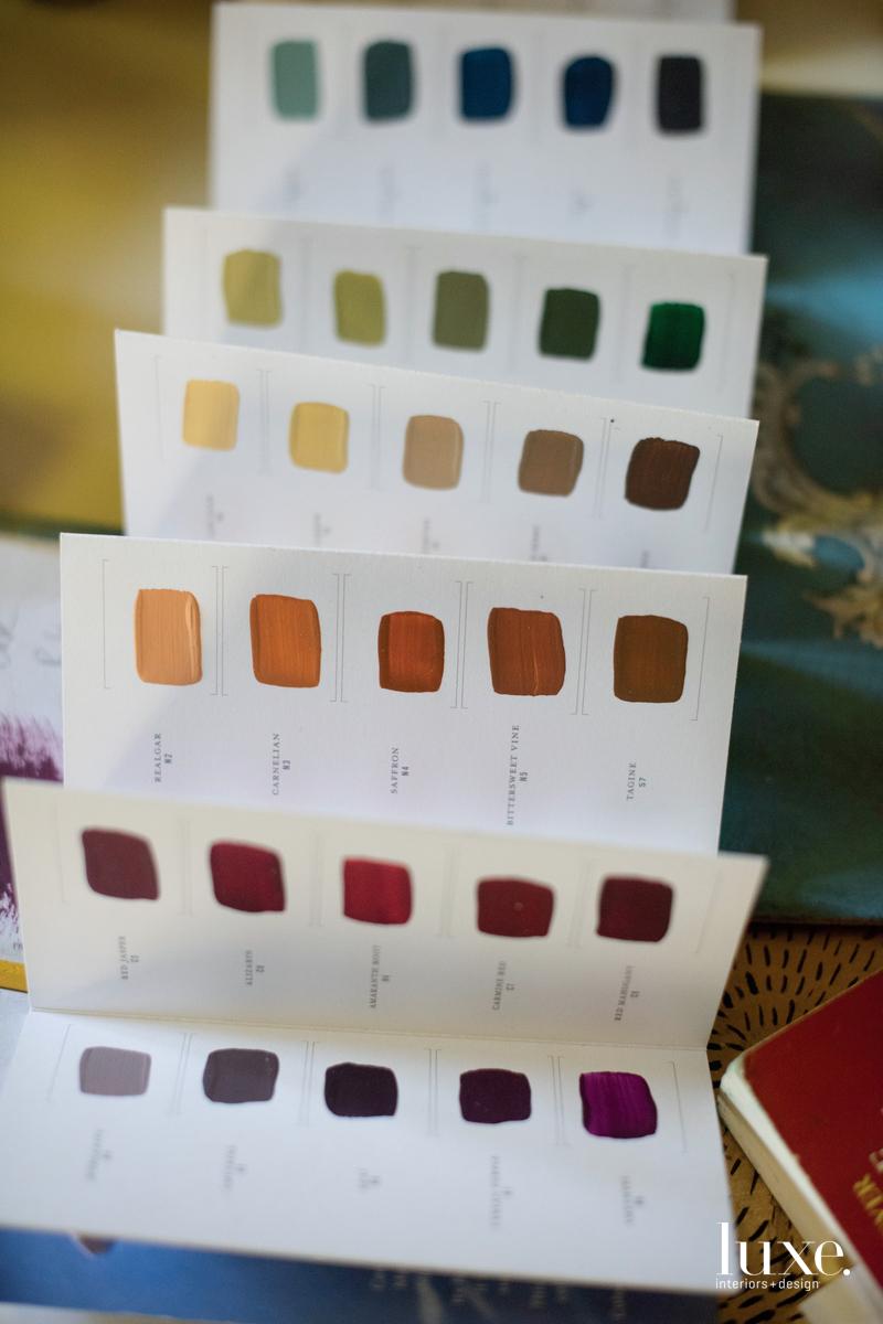 Tools of Lizarraga's trade include paint samples.