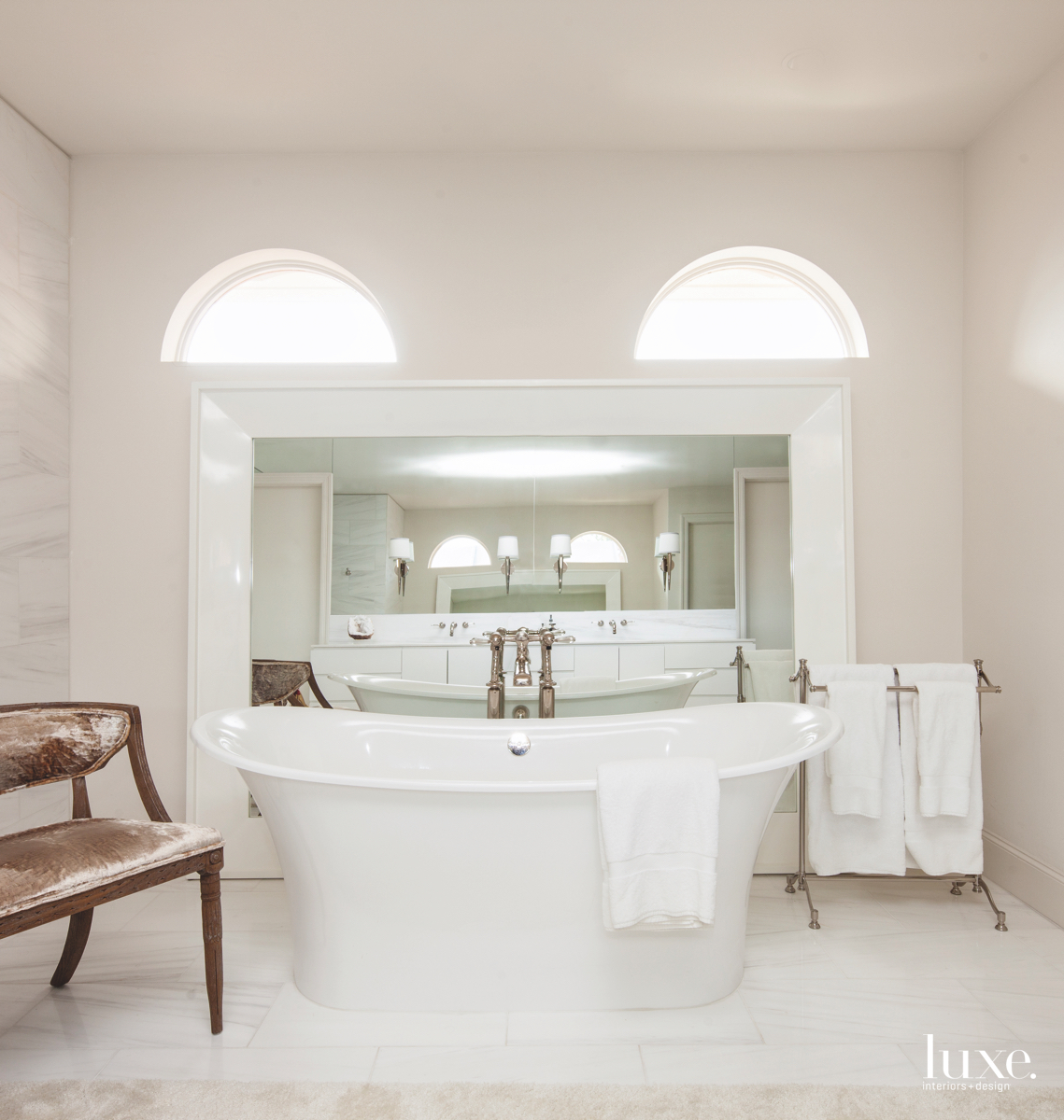 eclectic white marble master bathroom...