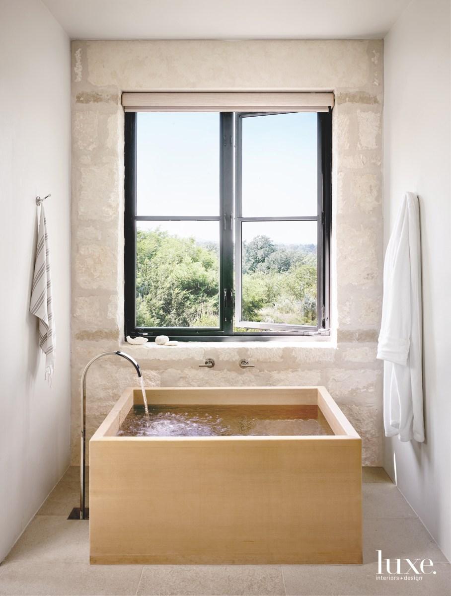 contemporary bathroom square bathtub neutral...