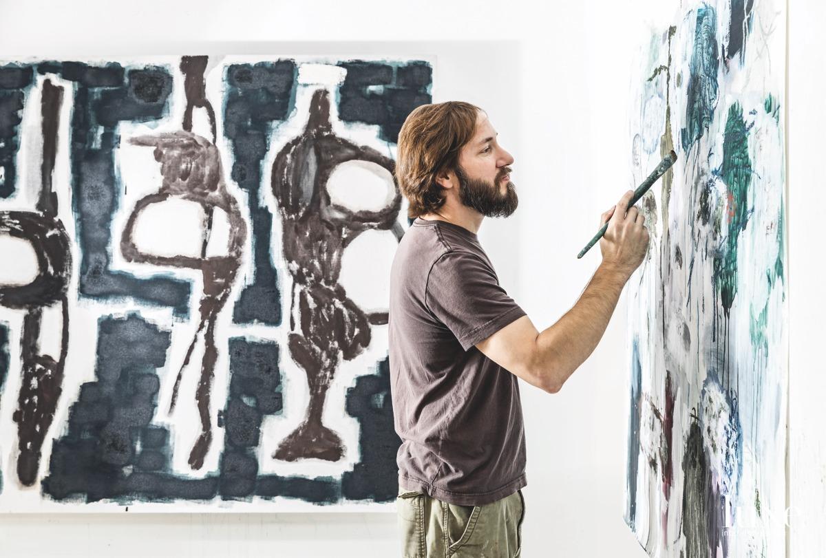 Abstract artist Stephen Battle is shown completing a piece titled Gathering Origins and Territory.