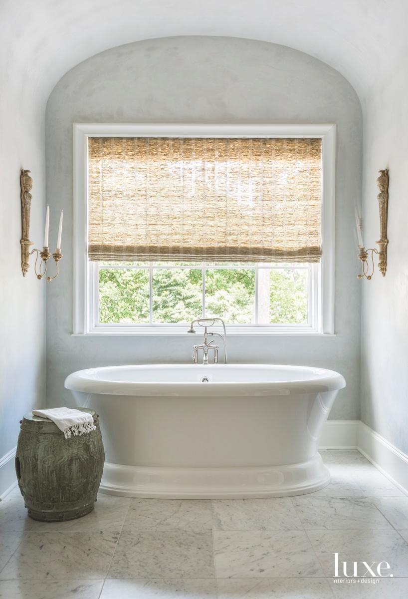 traditional white bathroom freestanding tub