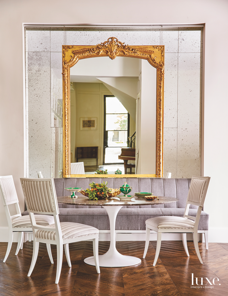 traditional dining area antique mirror...