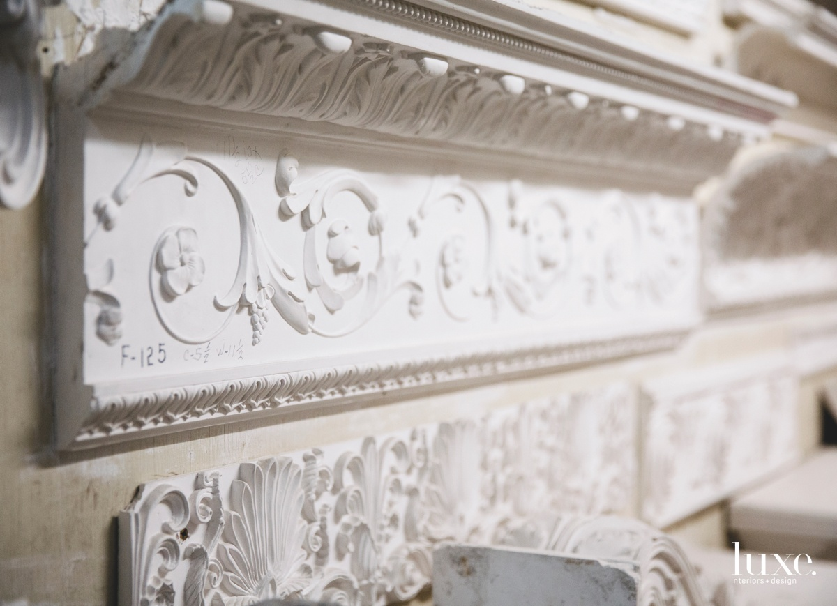 Samples on display in the studio include a French-motif crown molding.