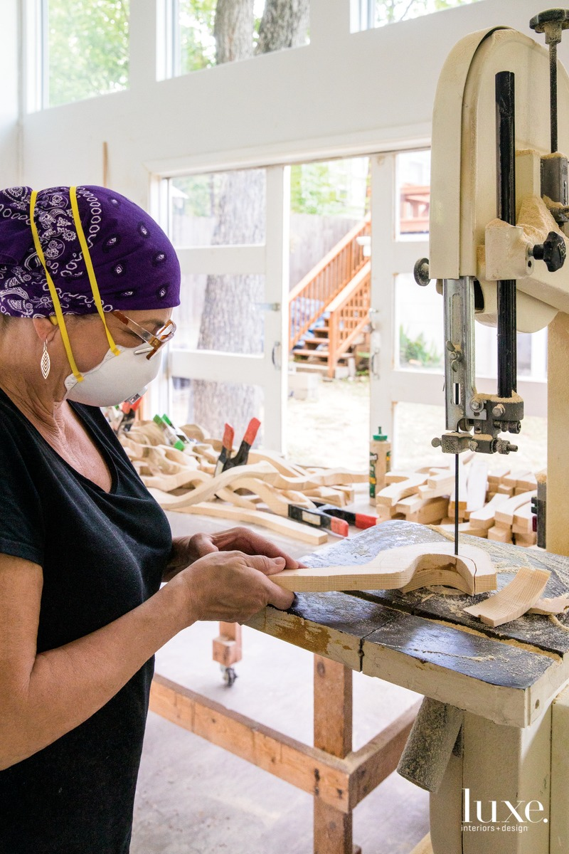 Pierucci uses a band saw to carve and cut smaller pieces of wood that she assembles into larger sculptures.