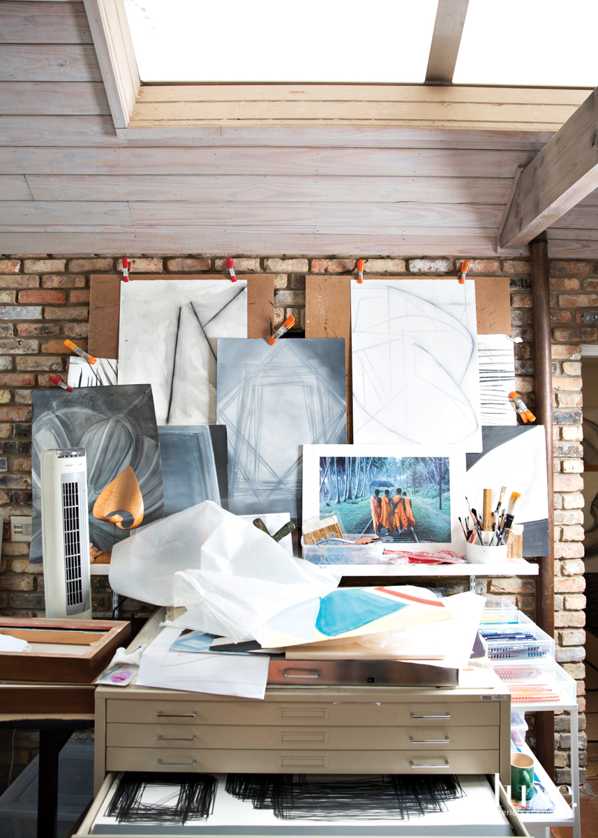 A flat-file cabinet in her studio stores hundreds of completed drawings.