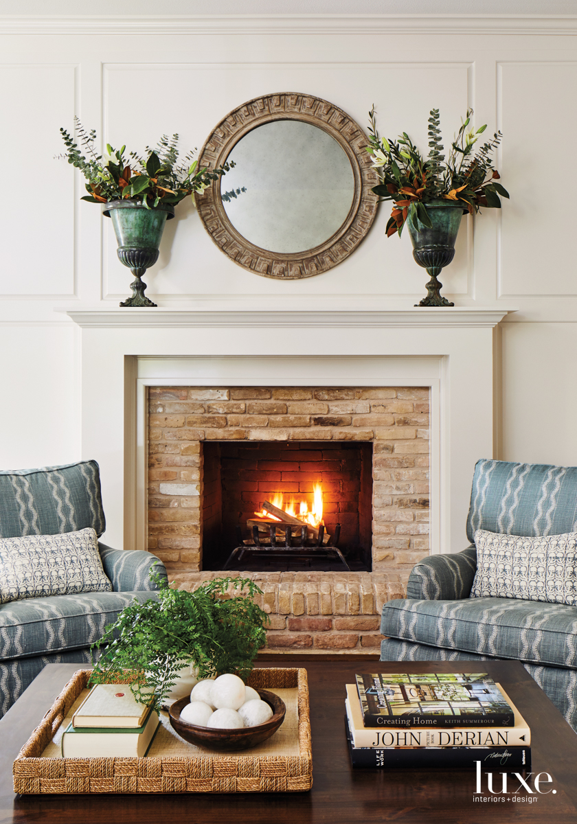 traditional living room neutral blue chairs fireplace coffee table