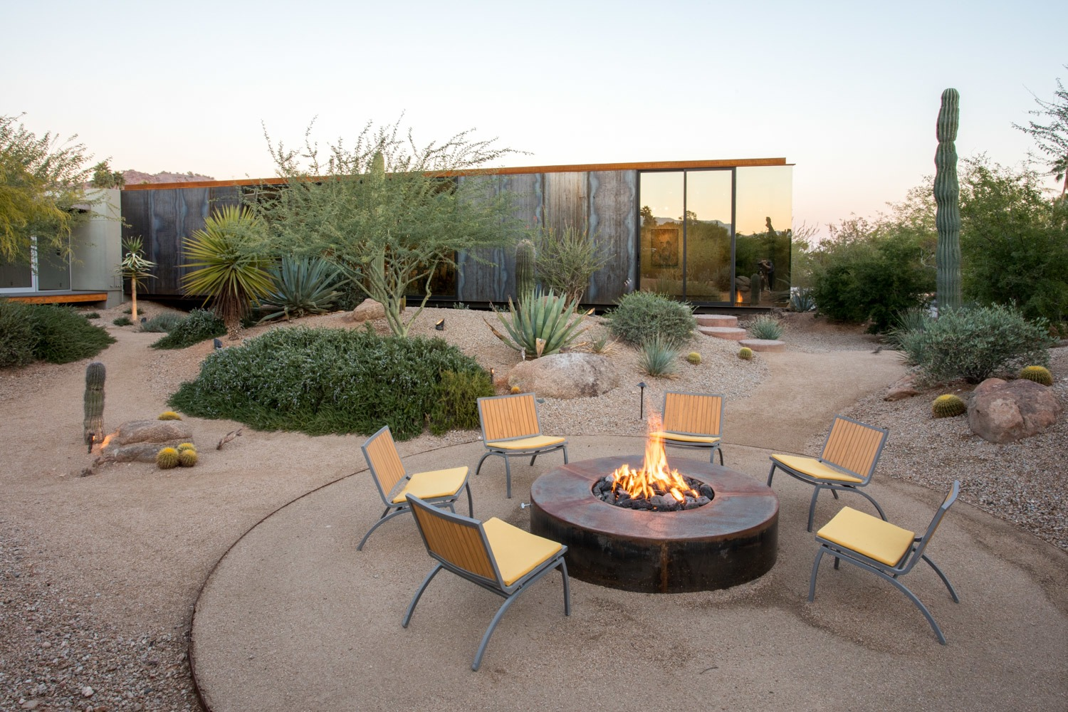 """The landscape was all in place there due to the existing courtyard,"" says Suchart. ""We largely designed and situated the project overall to be a good neighbor by embracing what was there and minimally disturbing the natural desert and, in particular, the wash."""