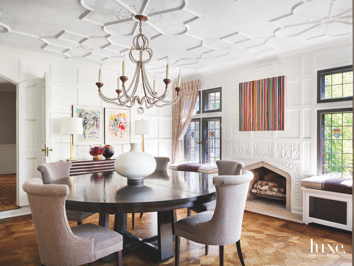 transitional dining room fireplace round...