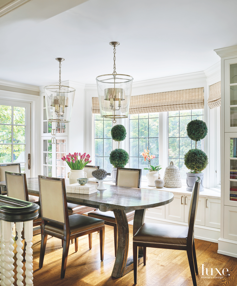 transitional dining area glass lanterns