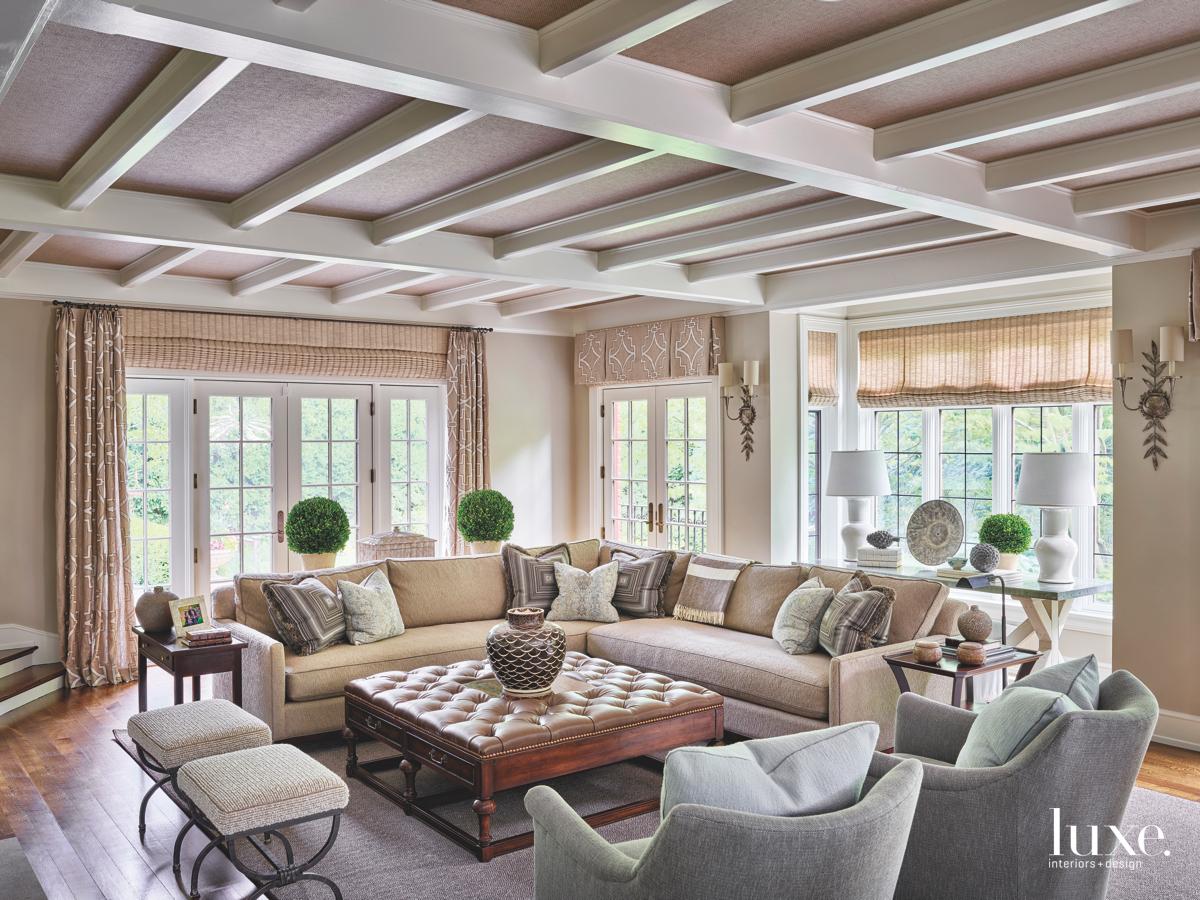 transitional living room white beam...