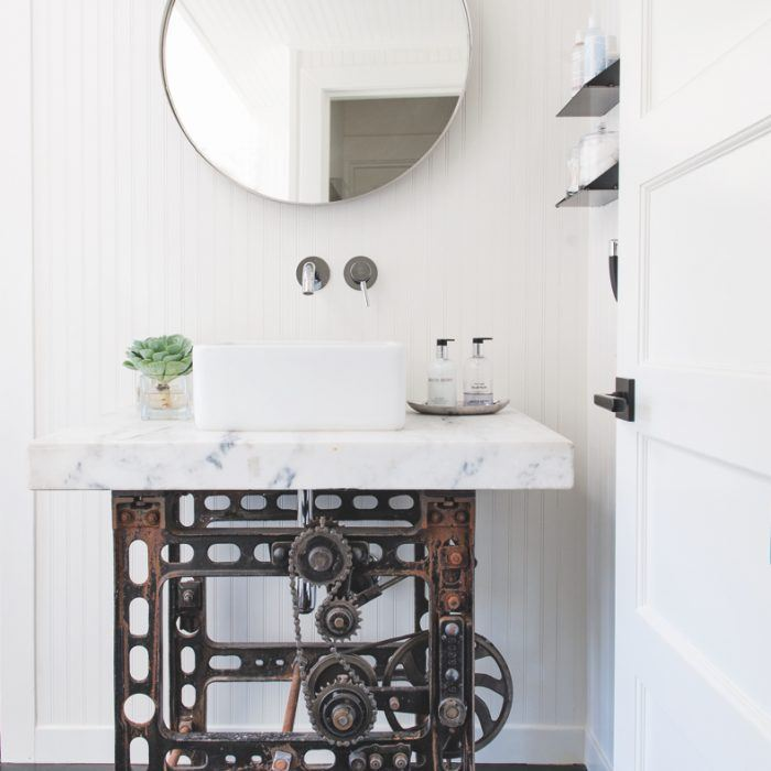 This Sonoma, California, space by Antonio Martins Interior Design pairs an antique industrial table holding a Toto sink with a Dornbracht faucet.