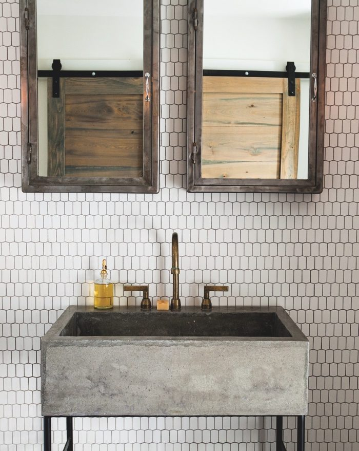 Elizabeth Ingram Studio outfitted this Roswell, Georgia, bathroom with Ann Sacks tile walls, a custom concrete sink by Knack Fab and a Kallista faucet.
