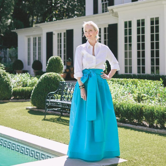 Striking a pose poolside, designer Danielle Rollins shows off one of her signature ball skirts.