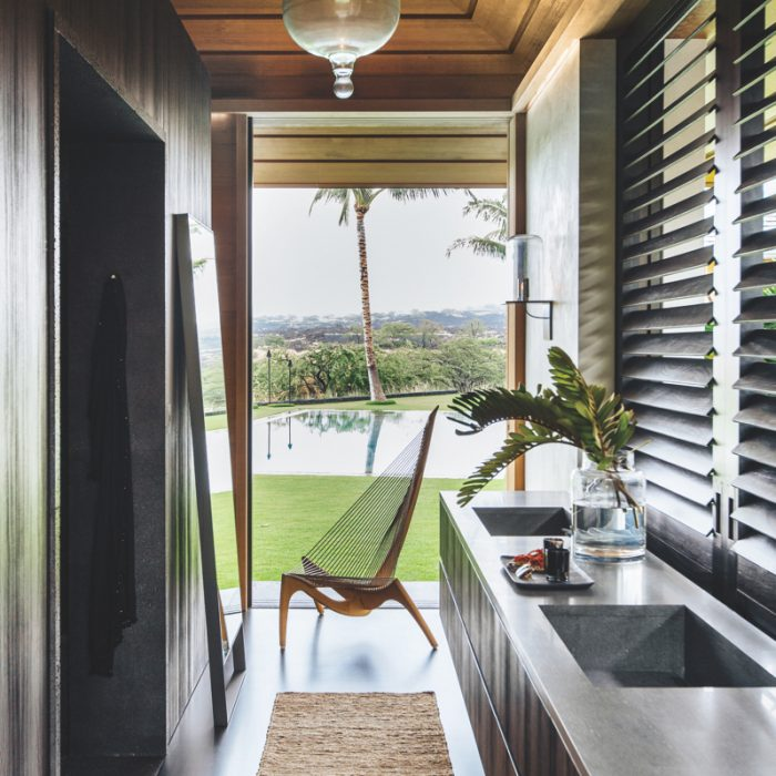 In this Hawaiian bathroom sanctuary, designer Nicole Hollis brought in color, textures and surfaces from the outside, giving the space a deep connection to the land.