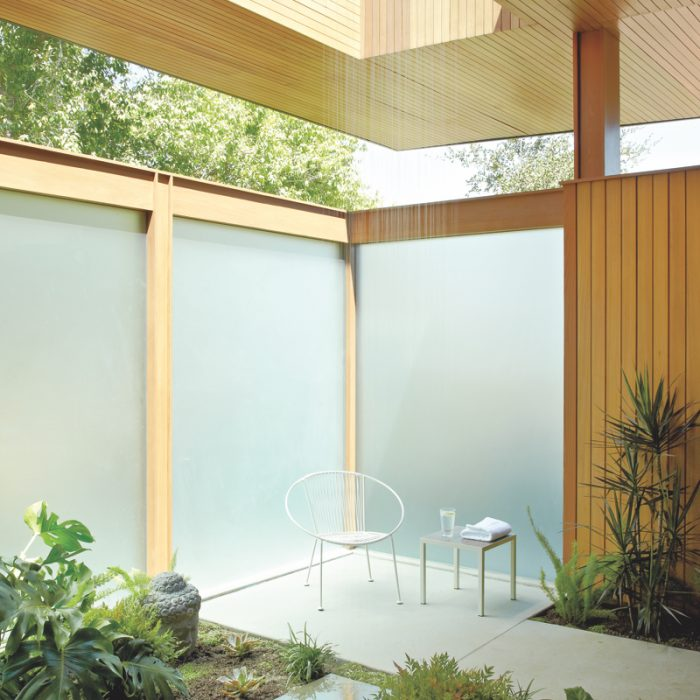 In this Pasadena, California, bathroom--a collaboration between Montalba Architects and Elysian Landscapes--concrete-and-terrazzo flooring blends with natural greenery.