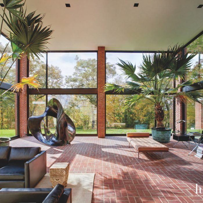 Consisting of a series of connecting steel, brick and glass pavilions, the home encourages a strong connection to nature, thanks to its expansive windows.