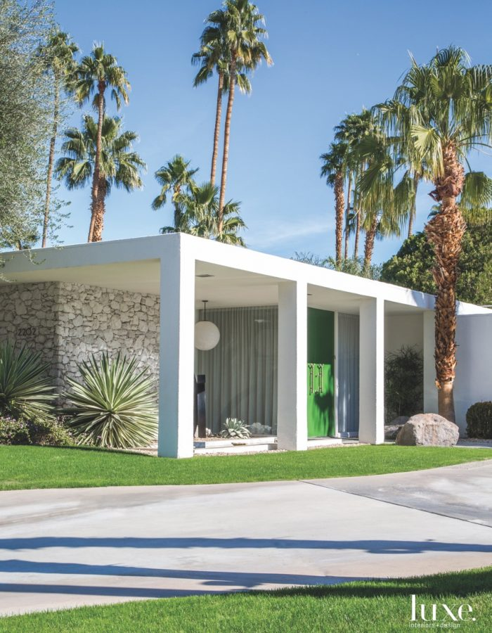 An elegant pair of green doors offers a whimsical welcome at this Palm Springs home.