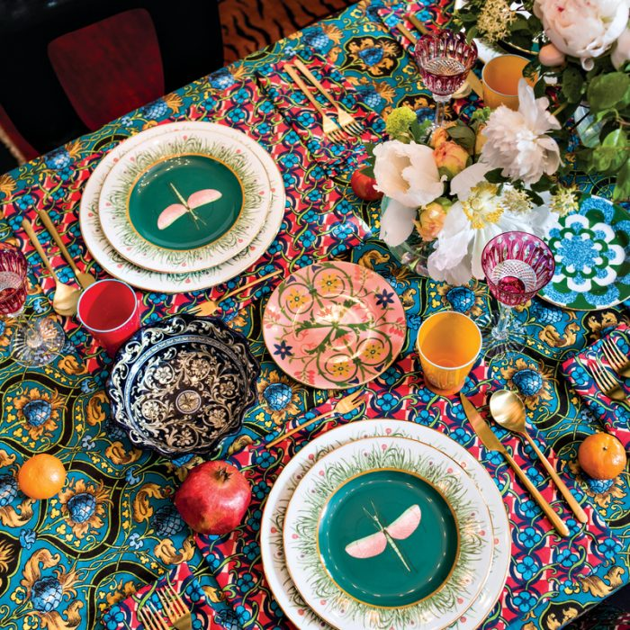 The forecast is always festive with an eclectic mix of tableware and linens, such as these from La Double J. The Libellula plate, shown here, was inspired by a print found in an 1896 natural history textbook.