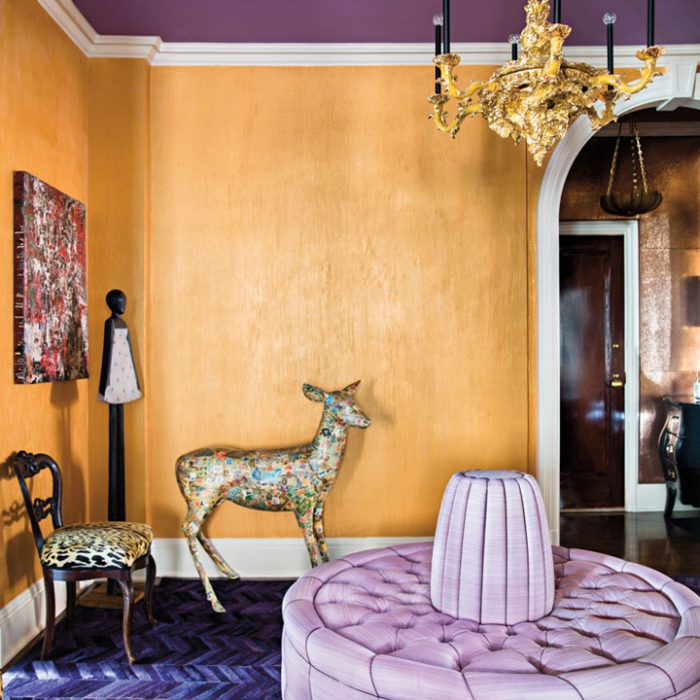 purple and gold room with chandelier