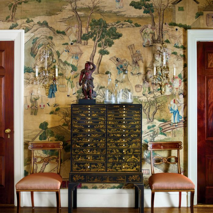 A lifelong collection of Asian antiques, including this showstopping 18th-century Chinese wallpaper, takes center stage at designer Ellie Cullman's New York apartment.