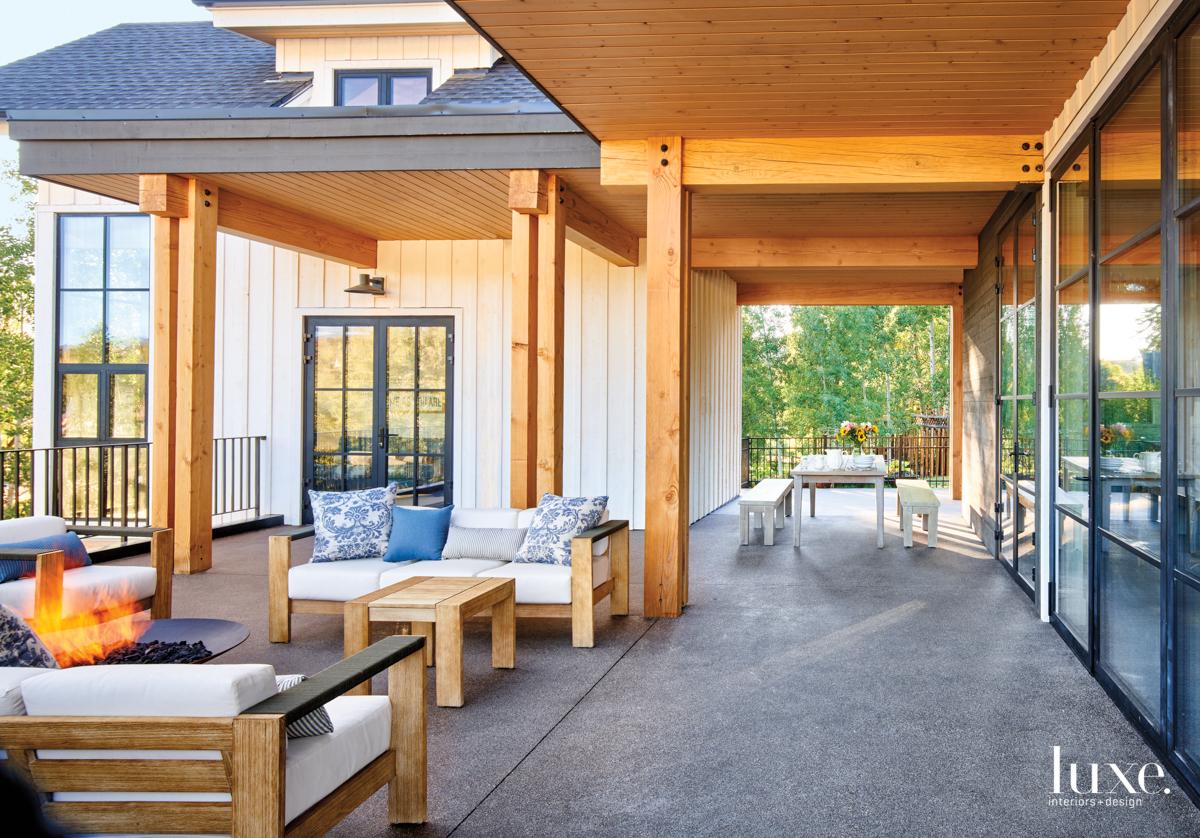 modern exterior sitting area fire...