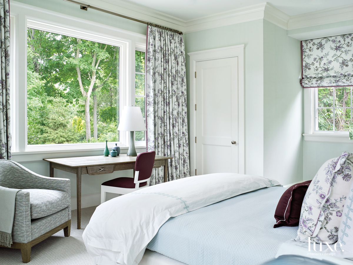 soft blue bedroom with roman...