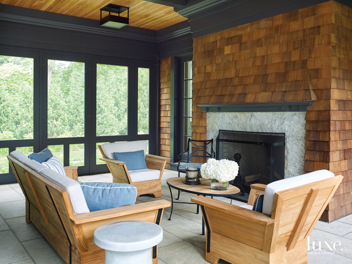 screened porch with teak and...