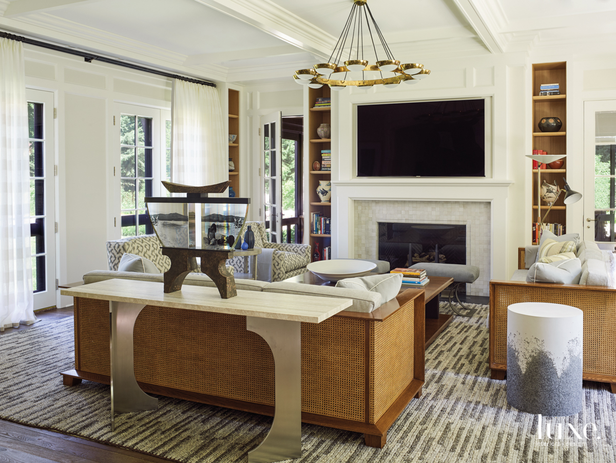 family room with caned sofas...