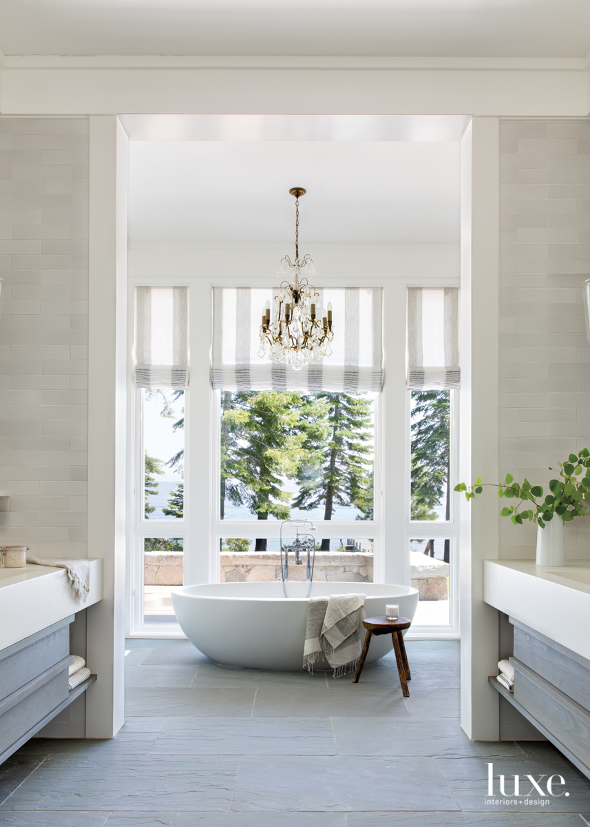transitional white bathroom white freestanding...