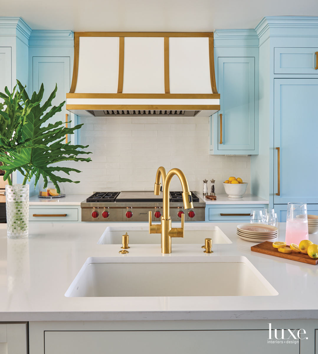 coastal kitchen blue cabinetry gold...