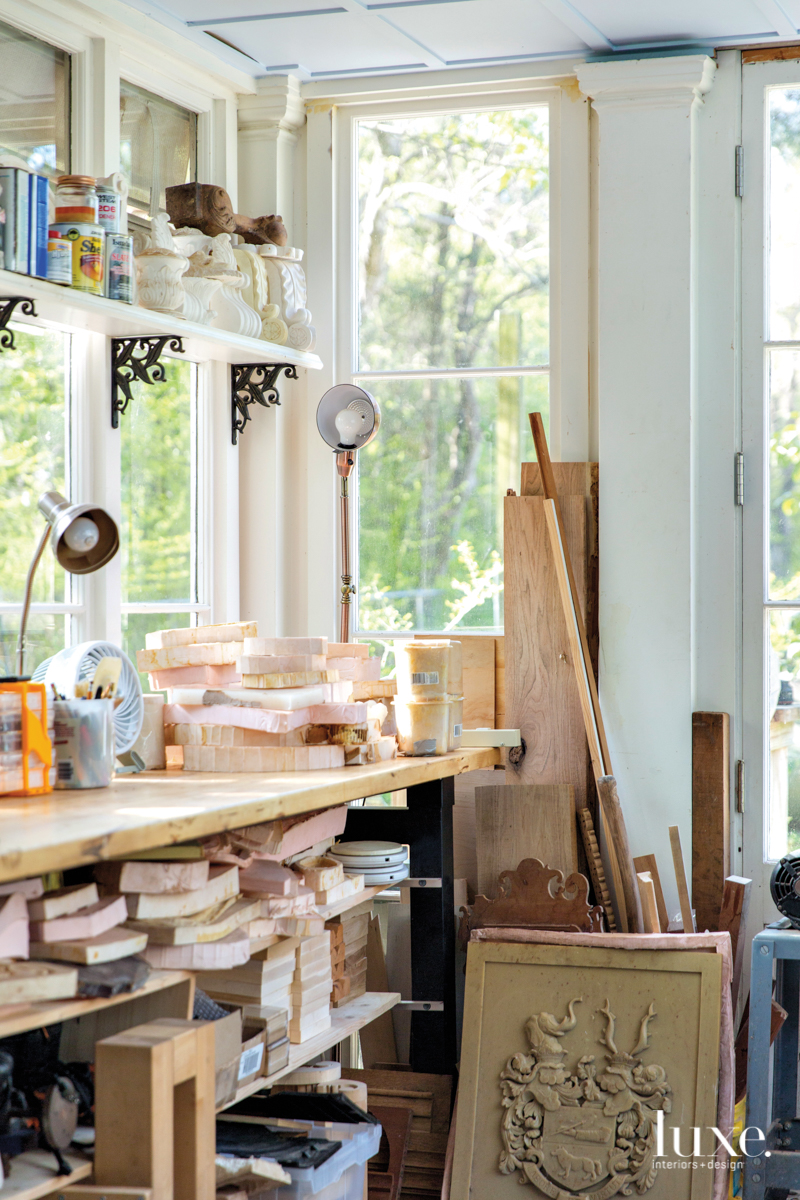 Sited among several oak-shrouded acres on the outskirts of Charleston, Mary May's creative space is ensconced in a white-clapboard cottage hand-built by her husband.