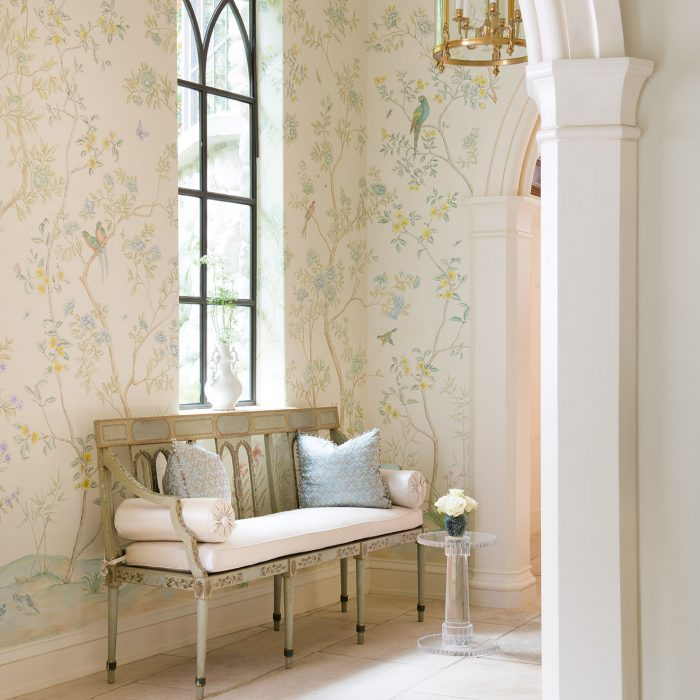 From the new Betty Lou Phillips book, French Refreshed: A glazed canapé from Legacy Antiques takes pride of place in this anteroom by Deborah Walker. Hand-painted walls are the work of Dallas artist Carol Cravens. Pillows are Fortuny.
