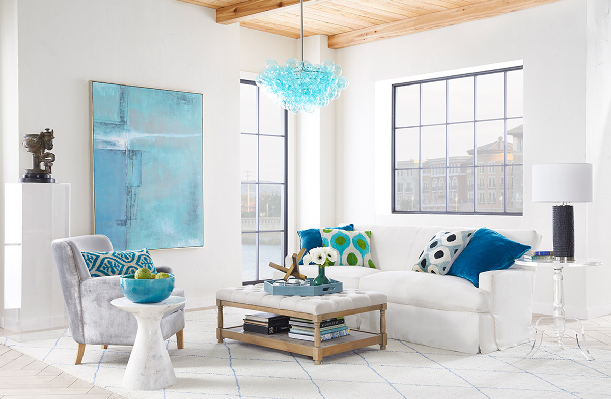 This living room is a symphony of white and various shades of blue, suggesting a seaside cottage.