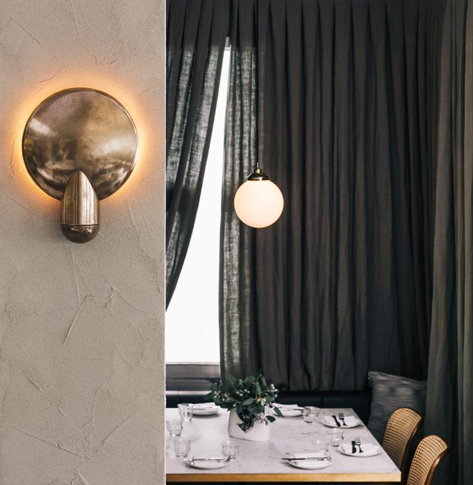 The Surface Wall Sconce is shown in cast bronze. Habachy Designs carries the fixture in a gunmetal cast-bronze finish.