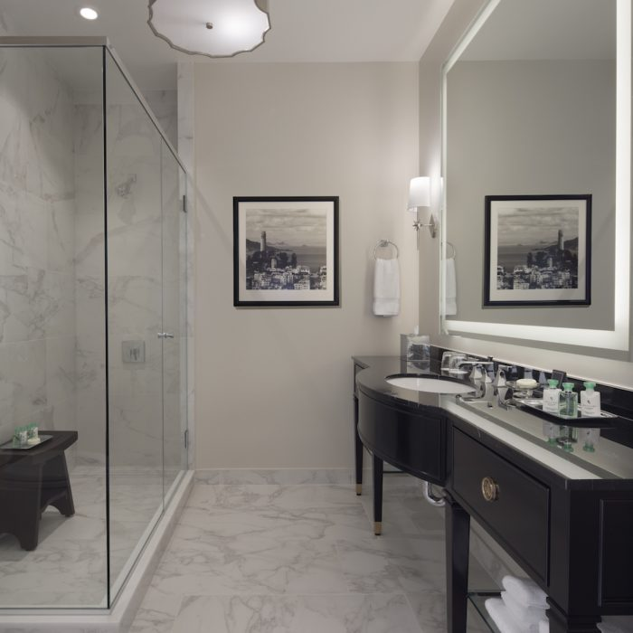 The bathrooms are designed with heated floors and large fog-free mirrors.