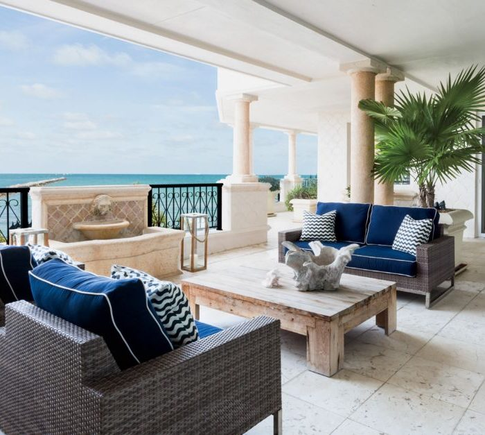 Shades of sea and sky offer a vacation from formality in this casually dressed Fisher Island retreat designer with family and friends in mind.