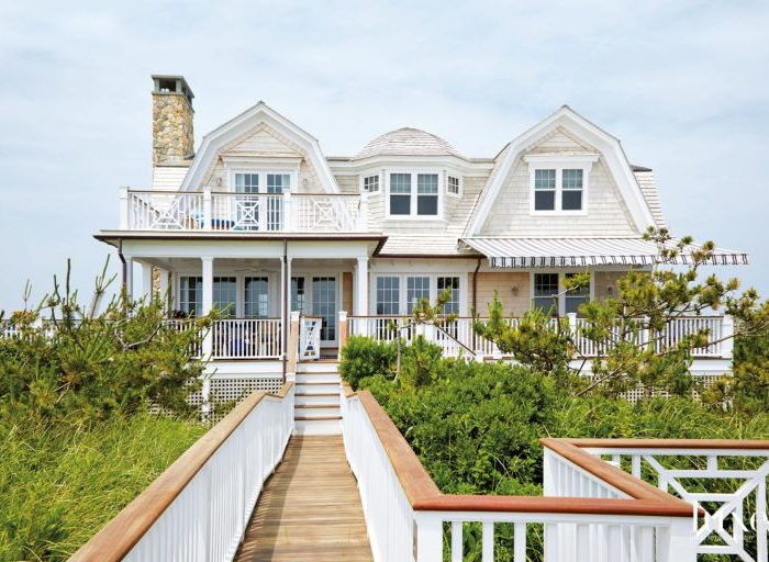 To take advantage of the waterfront location, porches, terraces and paths that lead from the home to the beach were added, and on the bay side is a new pool and pool house. Despite the new elements, though, there was a focus on maintaining the beach cottage theme.